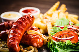 Grilled sausages, French fries and vegetables - 206666591