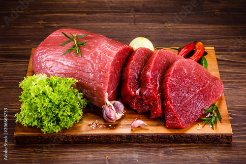 Leinwanddruck Bild Fresh raw beef steaks on white background