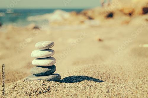 Fotobehang Zen Stenen Balance of stones on the beach. Vintage tinting