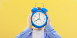 young person with clock or alarm, concept of time and punctuality - 206677365