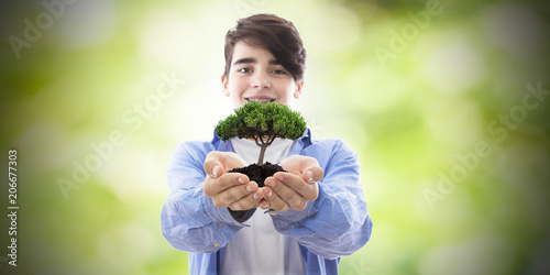 young tree in hands, conservation and nature - 206677303