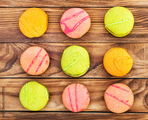 Plexiglas Macarons Rows of colorful macaroons on wooden background. Top view.