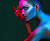 Fashion model woman in colorful bright sparkles and neon lights posing in studio, portrait of beautiful sexy girl. Art design colorful vivid makeup - 206691760
