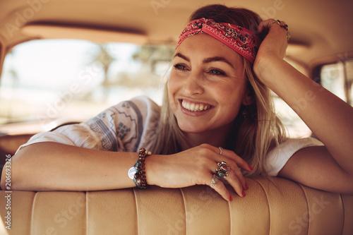 Leinwanddruck Bild Woman sitting in the car and looking away