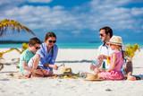 Family on a tropical beach vacation - 206694519