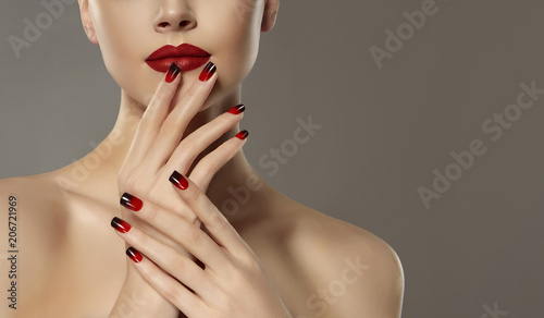 Fotobehang Manicure Beautiful model girl with red and black french manicure on nails . Fashion luxury makeup . Beauty and cosmetics .