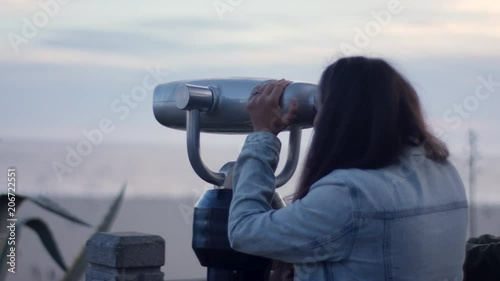 Sticker Woman Looks Through Telescope Out At Ocean View, Her Friend Stands Next To Her (Shot On Red Scarlet-W Dragon In 4K, Slow Motion)