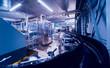 Leinwandbild Motiv Beverage factory interior. Conveyor with bottles for juice or water. Equipments