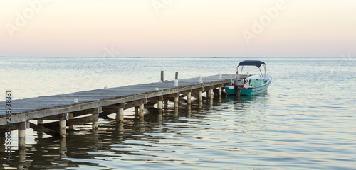 Fotobehang Pier Boat And Jetty At Sunrise