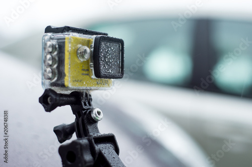 action camera all in a drop after a heavy road by car - 206748381