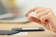 Woman hand holding a micro sim card - 206755109
