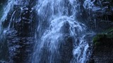 Loop of water cascading down stone waterfall - 206772581