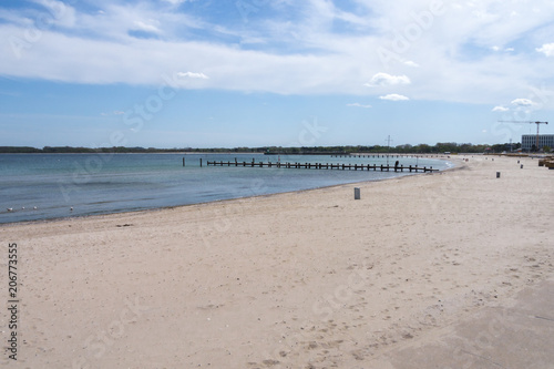 Canvas Pier beach on the baltic sea with a view of two wooden bridges