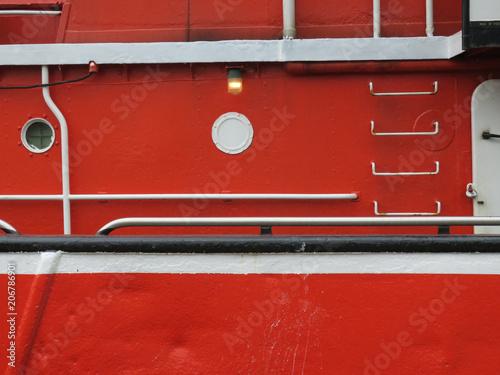obraz PCV red fishermans boat in the harbor of Scheveningen