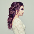 Leinwanddruck Bild - Brunette woman with long and shiny curly hair