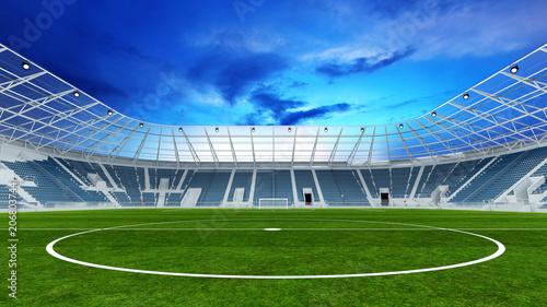 Leinwanddruck Bild Leeres Fußballstadion abends mit Rasen