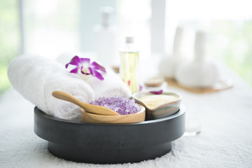 Spa accessories aromatic candle,orchid flower, salt scrub and towel. © barameefotolia