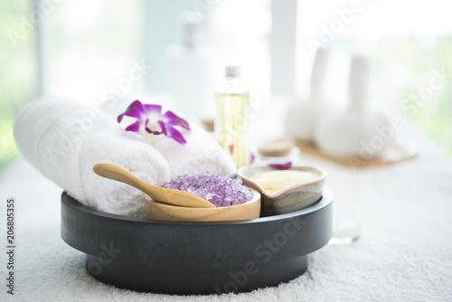 Fototapeta samoprzylepna Spa accessories aromatic candle,orchid flower, salt scrub and towel.