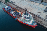 Container ship in export and import business and logistics. Shipping cargo to harbor by crane. Aerial view - 206817385