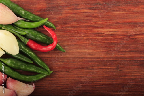 Aluminium Hot chili peppers chili pepper and garlic on woooden background