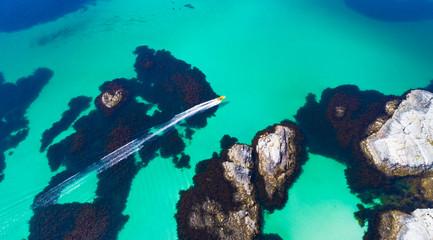 Aerial drone beach boat surf