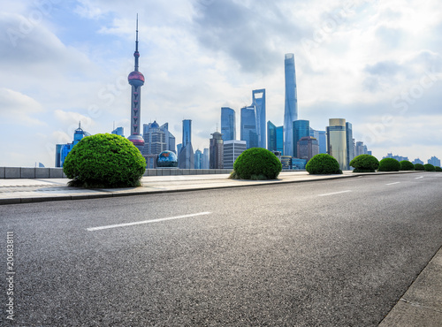 Fotobehang Shanghai Shanghai,China modern city skyline and empty asphalt road