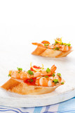Shrimp snacks with bread.