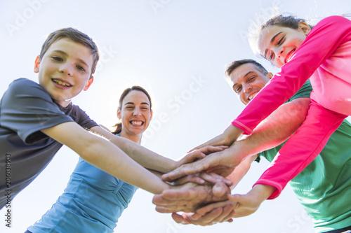 Leinwanddruck Bild Parents with children sport running together outside