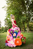 Young woman in an unusual skirt of flowers - 206839139