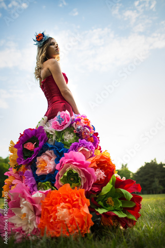 Young woman in an unusual skirt of flowers