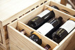 bottles of wine in a wooden box