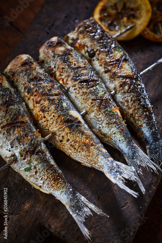 Sticker Grilled fish on metal skewers in close-up