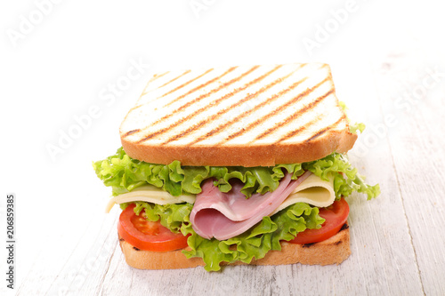 sandwich with lettuce, cheese and ham