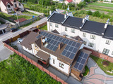 aerial view of house with solar roof. clean energy - 206873142