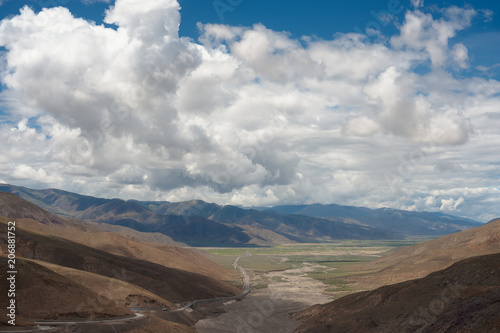 Fotobehang Cappuccino A Himalayan landscape with fluffy clouds