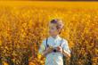 Leinwanddruck Bild - Portrait of little boy photographer with camera on sunset yellow field background