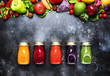 Food and drinks, healthy and useful multicolored vegetable juices and smoothies with ingredients in glass bottles, set on gray background, top view - 206896147