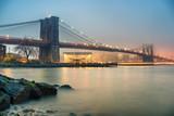 Brooklyn bridge and Manhattan at foggy evening, New York City - 206897717