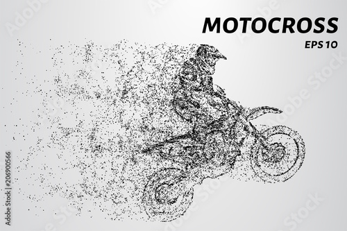 Motocross particles. Motorcyclist rides on the rear wheel