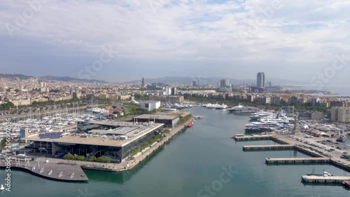 Aerial footage of Barcelona, Spain. moving across the city's port facing Barcelona's skyline.