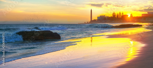 Beach and view of Maspalomas lighthouse at sunset.  Gran Canaria, Spain - 206906975