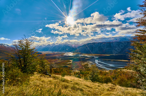 A view of the mountains and the valley, which illuminates the autumn sun making its way through the clouds. Argentine Patagonia in Autumn © Vitaly