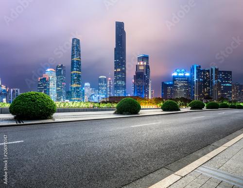 Fotobehang Purper asphalt road and modern city skyline in Guangzhou at night,China
