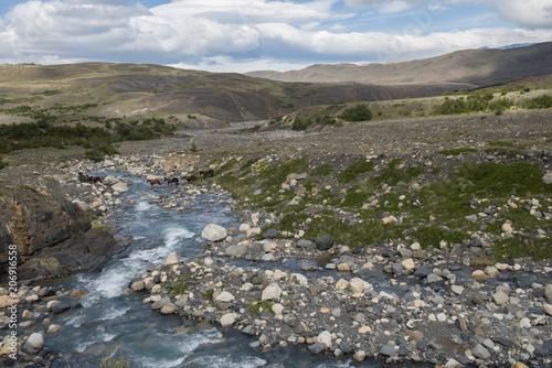 Fotobehang Bergrivier Patagonia, river and horses