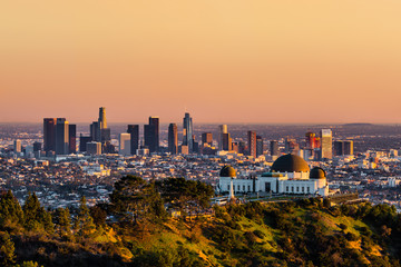 Los Angeles skyscrapers and Griffith Observatory at sunset