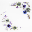 Flowers composition. Frame made of colorful flowers on gray background. Flat lay, top view, square