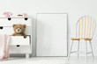 Leinwanddruck Bild - Poster with mockup between chair and cabinet with teddy bear in kid's room interior. Real photo
