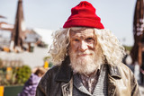 Way of life. Positive homeless man smiling while looking at you - 206948384