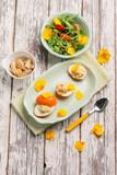 curcuma stuffed egg with mixed salad - 206952387