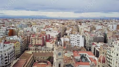 Spain, Valencia aerial shooting, bird-eye view on red roofs and squares, and roads. beautiful buildings and streets, view from the sky